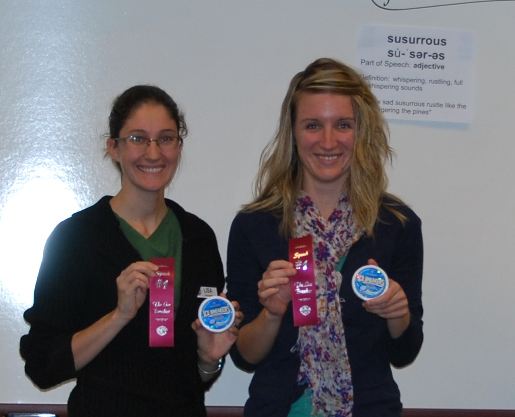 Lisa (L) and Laura with awards for first speech at Chippewa Valley Toastmasters